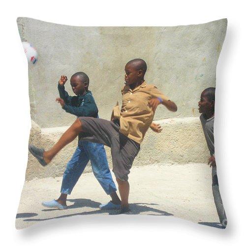 Haiti - Soccer Throw Pillow featuring the photograph Haitian Boys Playing Soccer by Steven Baier