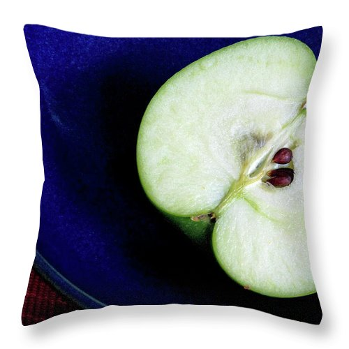 Healthy Eating Throw Pillow featuring the photograph Half Of A Green Apple In A Blue Bowl by Rebecca E Marvil
