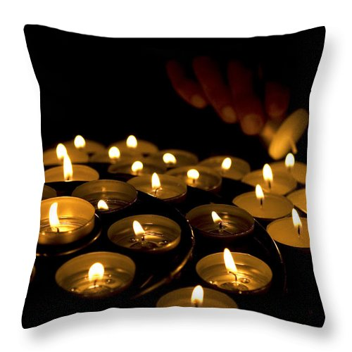 Close Up Throw Pillow featuring the photograph Hand Lighting Candles by Fabrizio Troiani