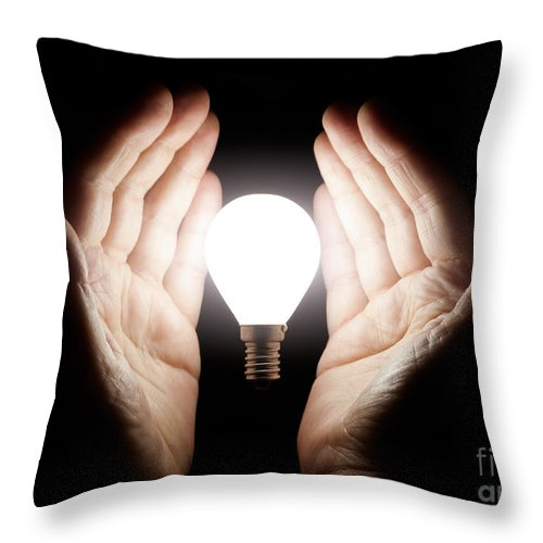 Light Bulb Throw Pillow featuring the photograph Hands Holding Light Bulb by Simon Bratt Photography LRPS