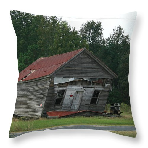 Old Buildings Throw Pillow featuring the photograph Hanging On by Marty Fancy