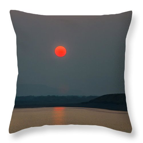 Sunset Throw Pillow featuring the photograph Hanging Sun by Robert Bales