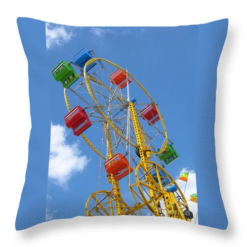 Carnival Throw Pillow featuring the photograph High Wheeling by Ann Horn
