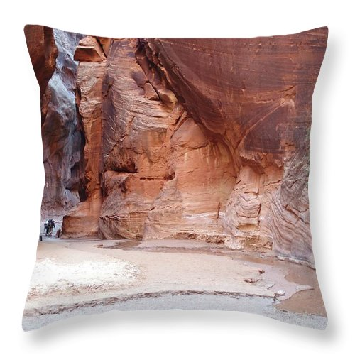 Tranquility Throw Pillow featuring the photograph Hikers Entering Buckskin Gulch From by Photograph By Michael Schwab