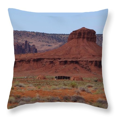 Navajo Throw Pillow featuring the photograph Hogans by Keith Stokes