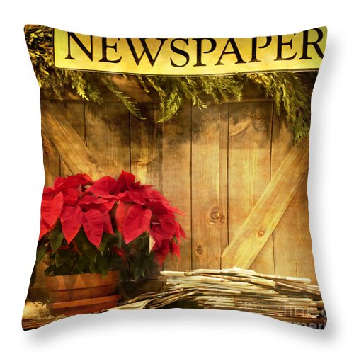 Christmas; Country; Newspaper; Sign; Vintage; Wood; Home; Business; Flowers; House; Red; Wooden; Holiday; Pile; Seasonal; Brown; Table; Garland; Greenery; Christmastime; Store; Poinsettia Throw Pillow featuring the photograph Holiday News by Margie Hurwich