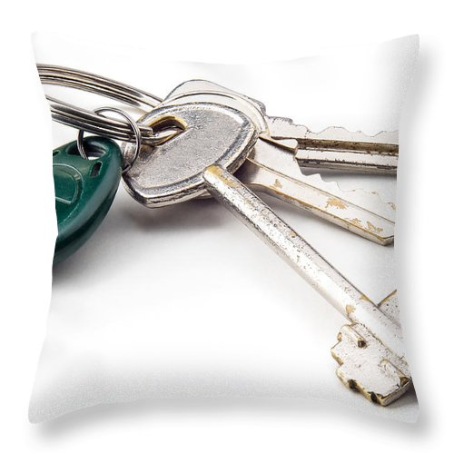 Iron Throw Pillow featuring the photograph Home Keys by Alain De Maximy