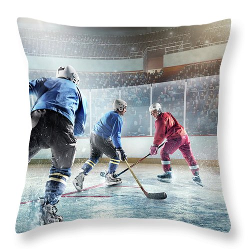 Sports Helmet Throw Pillow featuring the photograph Ice Hockey Players In Action by Dmytro Aksonov