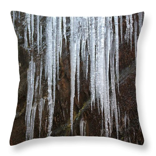 Icicles Throw Pillow featuring the photograph Icicles On A Cliff by Dwight Cook