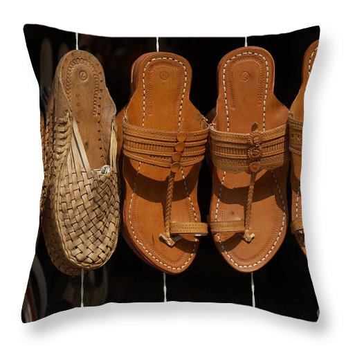 Footware Throw Pillow featuring the photograph Indian Footware by Milind Ketkar