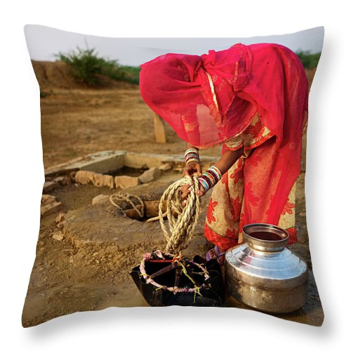 Working Throw Pillow featuring the photograph Indian Woman Getting Water From The by Hadynyah