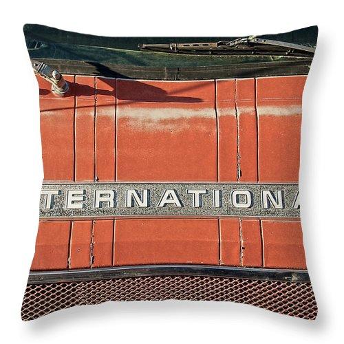 International Throw Pillow featuring the photograph International by Britt Runyon