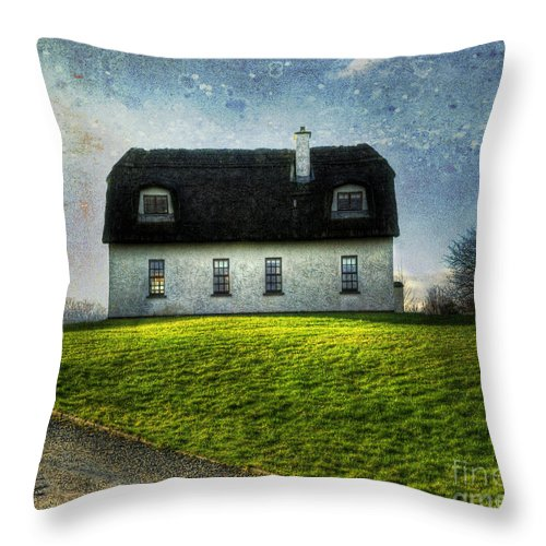 Accommodation Throw Pillow featuring the photograph Irish Thatched Roofed Home by Juli Scalzi