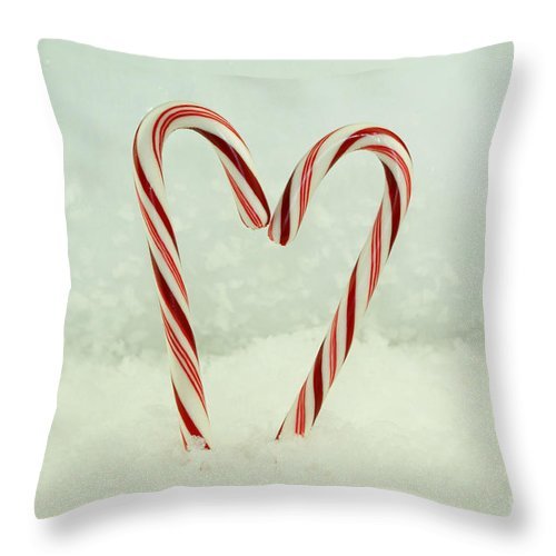 Candy Cane Throw Pillow featuring the photograph It Must Be Love by Valerie Fuqua