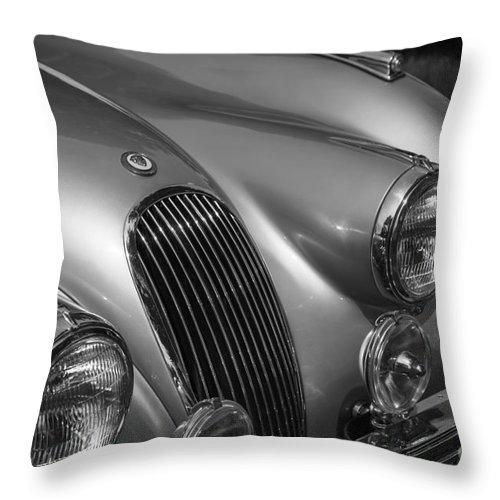 Jaguar.xk120 Throw Pillow featuring the photograph Jaguar Xk 120 by Dennis Hedberg