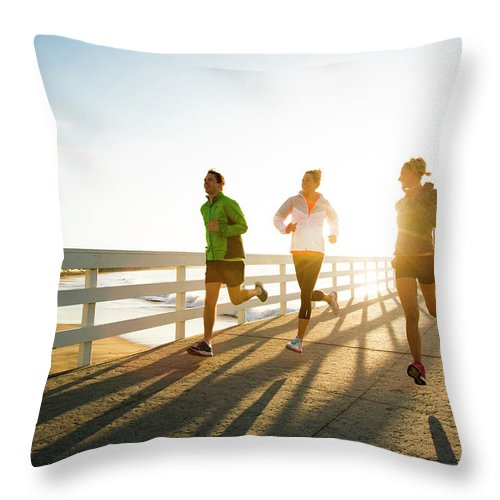 Young Men Throw Pillow featuring the photograph Jogging Along The Coast by Jordan Siemens
