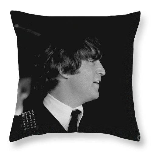 Beatles Throw Pillow featuring the photograph John Lennon, Beatles Concert, 1964 by Larry Mulvehill