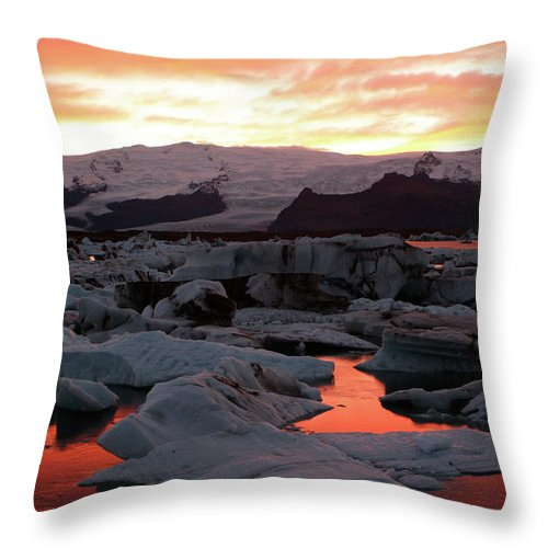 Scenics Throw Pillow featuring the photograph Jokulsarlon Lagoon At Sunset by Richard Collins