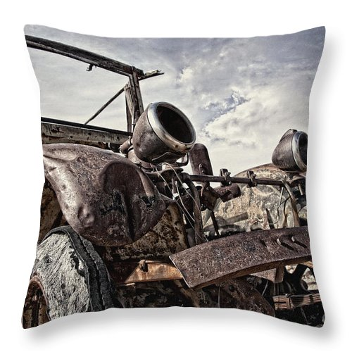Old Truck Throw Pillow featuring the photograph Junk Yard Sentinel Stands by Lee Craig