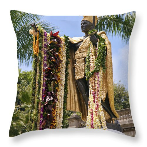 Aliiolani Throw Pillow featuring the photograph Kamehameha Covered In Leis by Brandon Tabiolo