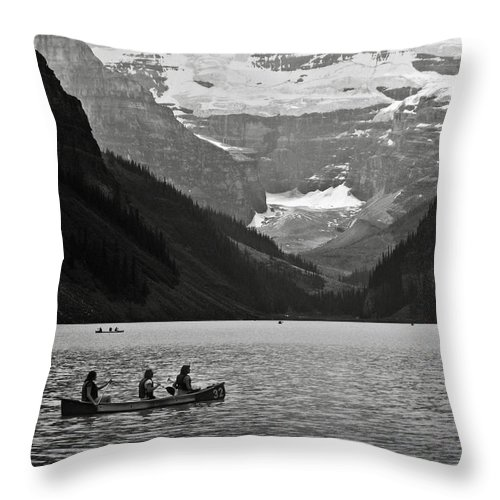 Lake Louise Throw Pillow featuring the photograph Kayak On Lake Louise by RicardMN Photography
