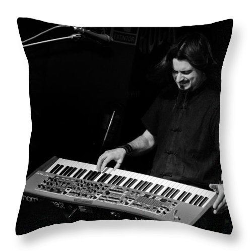Jero Throw Pillow featuring the photograph Keyboards by Pablo Lopez