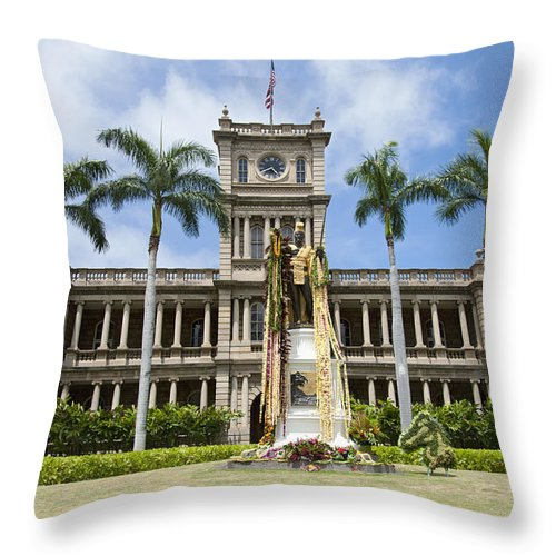 Aliiolani Throw Pillow featuring the photograph King Kamehameha In Leis by Brandon Tabiolo