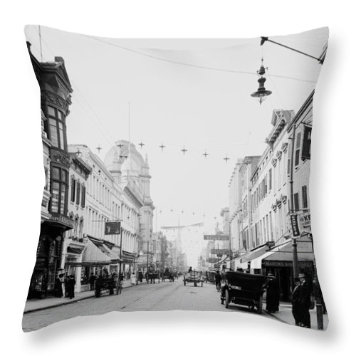 1910 Throw Pillow featuring the photograph King Street In Charleston South Carolina Circa 1910 by Mountain Dreams
