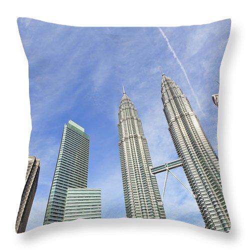 Corporate Business Throw Pillow featuring the photograph Kuala Lumpur Skyline by Tom Bonaventure
