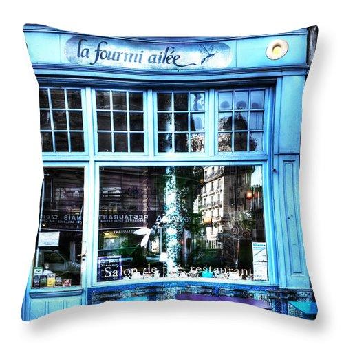 Evie Throw Pillow featuring the photograph La Fourmi Ailee Paris France by Evie Carrier