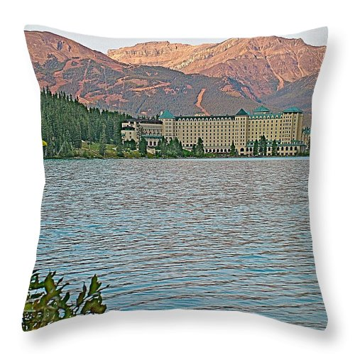 Sunset Over Chateau Lake Louise In Banff National Park Throw Pillow featuring the photograph Lake Louise Chateau At Sunset In Banff Np-alberta by Ruth Hager