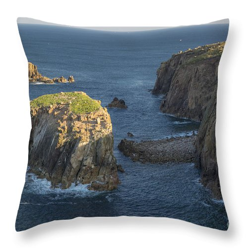 Armed Knight Throw Pillow featuring the photograph Lands End Cornwall by Brian Jannsen