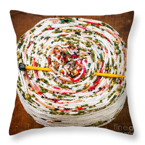 Knitting Throw Pillow featuring the photograph Large Ball Of Colorful Yarn by Les Palenik