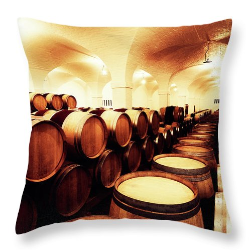 Alcohol Throw Pillow featuring the photograph Large Winery Cellar Filled With Oak by Rapideye