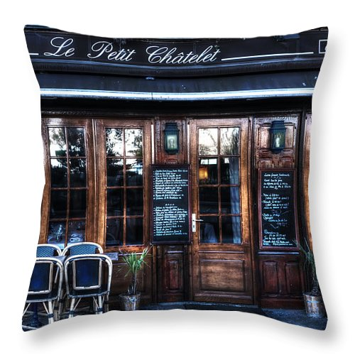 Evie Throw Pillow featuring the photograph Le Petit Chatelet Paris France by Evie Carrier