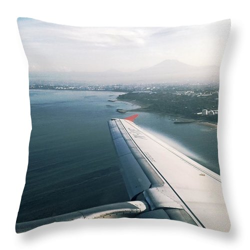 Airplane Throw Pillow featuring the photograph Leaving Bali by Lyle Barker