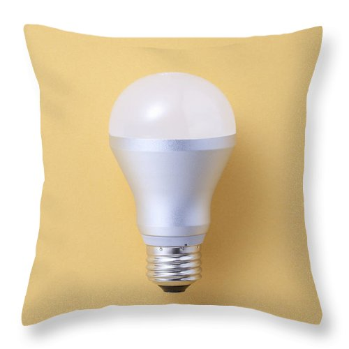 Environmental Conservation Throw Pillow featuring the photograph Led Bulb by Imagenavi