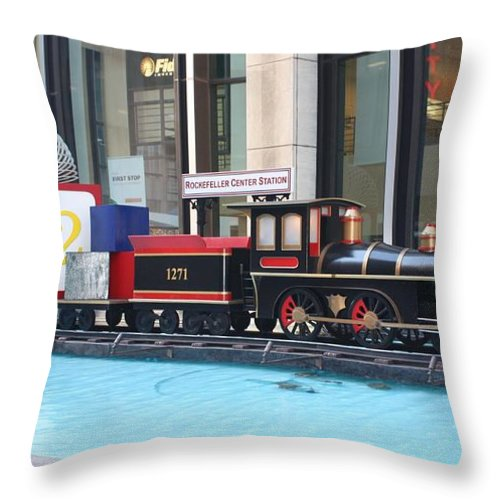 Life Size Toy Train Set In Nyc Throw Pillow featuring the photograph Life Size Toy Train Set In Nyc by John Telfer