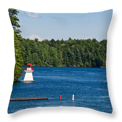 Lighthouse Throw Pillow featuring the photograph Lighthouse And Boathouse by Les Palenik