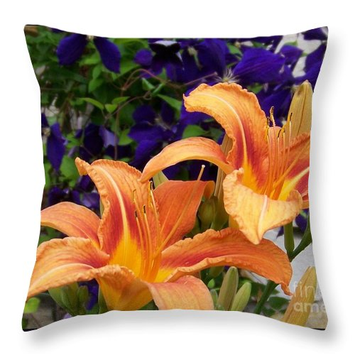 Lilies Throw Pillow featuring the photograph Lilies and Clematis by Jackie Mueller-Jones
