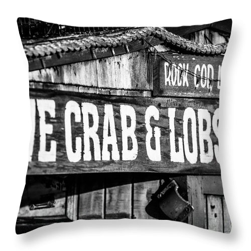 America Throw Pillow featuring the photograph Live Crab And Lobster Sign On Dory Fish Market by Paul Velgos