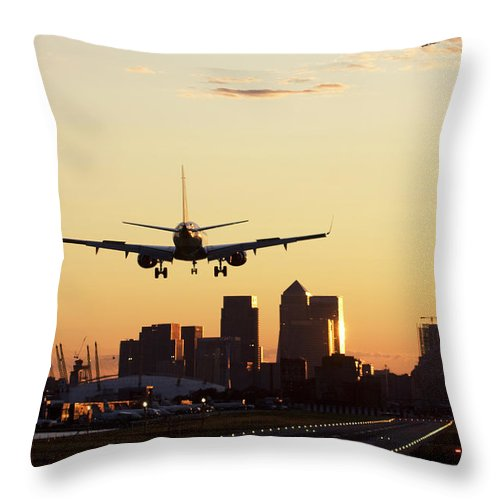 Taking Off Throw Pillow featuring the photograph London City Airport by Greg Bajor