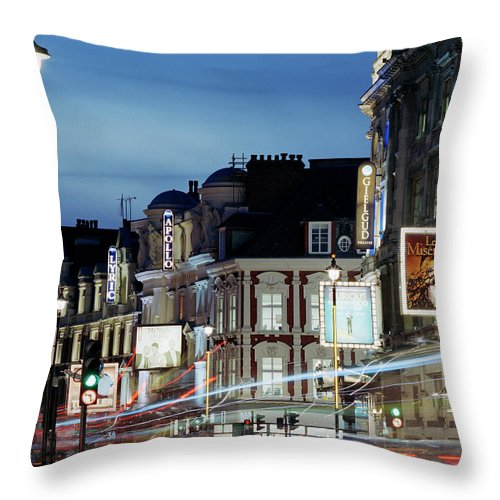 Recreational Pursuit Throw Pillow featuring the photograph Londons Shaftesbury Avenue At Dusk by Shomos Uddin