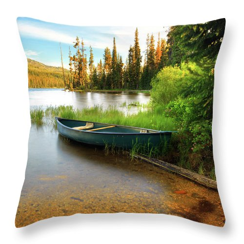 Tranquility Throw Pillow featuring the photograph Lone Canoe On Shores Of Upper Payette by Anna Gorin