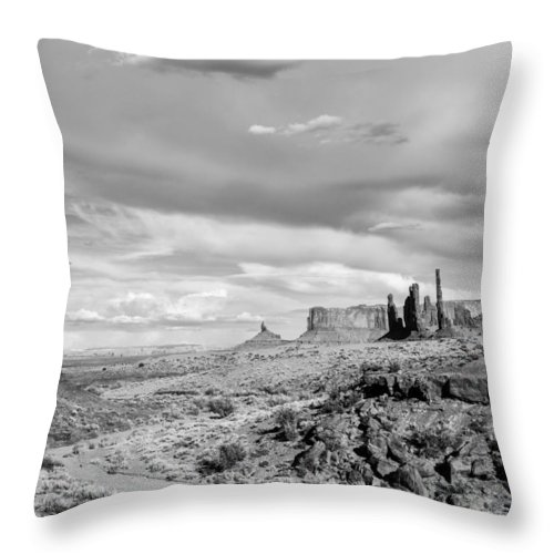 Monument Throw Pillow featuring the photograph Lonely Cloud And Totem Pole - Monument Valley Tribal Park Arizona by Silvio Ligutti