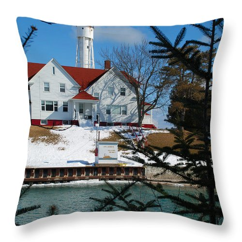 Lighthouse Throw Pillow featuring the photograph Looking Through The Pines - Sturgeon Bay Coast Guard Station by Janice Adomeit