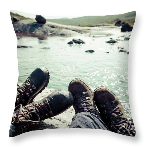 Tranquility Throw Pillow featuring the photograph Low Section Of Women Sitting On Rock At by Katja Kircher