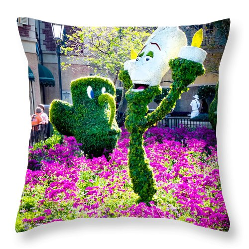 Beauty And The Beast Throw Pillow featuring the photograph Lumiere And Chip by Greg Fortier