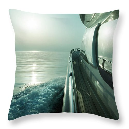 Desaturated Throw Pillow featuring the photograph Luxury Motor Yacht Sailing At Sunset by Petreplesea