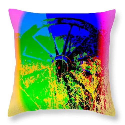 Wheel Throw Pillow featuring the photograph People Must Make The Wheel Go Round, Or Else The Grass Will Grow High And Bury It by Hilde Widerberg